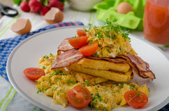 Scrambled eggs with bacon and French toast Royalty Free Stock Image