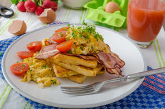 Scrambled eggs with bacon and French toast Stock Photography