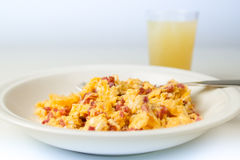 Scrambled eggs with bacon Stock Photo
