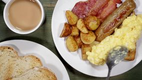 Scrambled eggs with bacon and sausage breakfast stock video footage