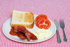 Scrambled eggs with bacon and tomato Royalty Free Stock Photo