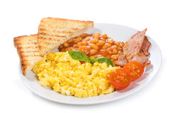 Scrambled eggs with bacon and vegetables Stock Photos