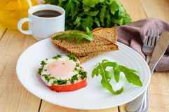 Scrambled eggs, baked in a ring bell pepper, toast, arugula leaves and a cup of coffee Royalty Free Stock Photo
