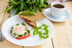 Scrambled eggs, baked in a ring bell pepper, toast, arugula leaves and a cup of coffee. Royalty Free Stock Photography