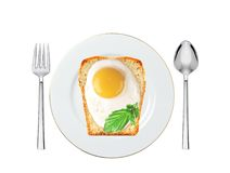 Scrambled eggs with bread and basil on plate isolated Royalty Free Stock Photos