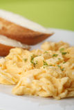 Scrambled eggs and bread with butter Royalty Free Stock Image