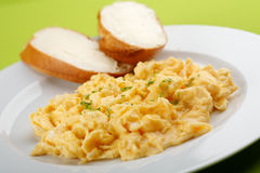 Scrambled eggs and bread with butter Stock Photo