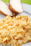 Scrambled eggs and bread with butter Stock Image