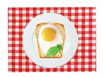 Scrambled eggs with bread on plate, on color napkin Stock Images