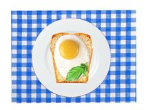 Scrambled eggs with bread on plate, on color napkin Royalty Free Stock Images