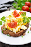 Scrambled eggs on bread Stock Image