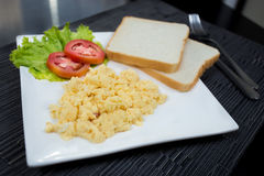 Scrambled eggs. And breads in the morning breakfast Stock Photography