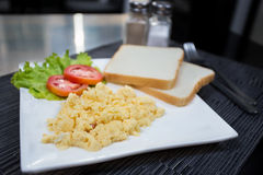 Scrambled eggs. And breads in the morning breakfast Royalty Free Stock Photos