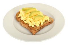 Scrambled Eggs Breakfast on Wholemeal Toast with Avocado Royalty Free Stock Photos