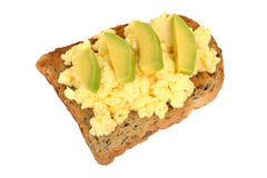 Scrambled Eggs Breakfast on Wholemeal Toast with Avocado on a plate isolated white background Stock Images