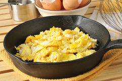 Scrambled eggs in a cast iron skillet Stock Photo