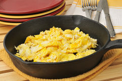Scrambled eggs in a cast iron skillet Royalty Free Stock Image