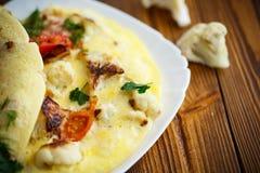 Scrambled eggs with cauliflower Stock Image
