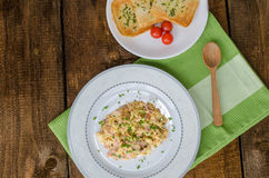 Scrambled eggs with chive and bacon, toast with herbs Royalty Free Stock Images