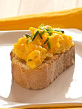 Scrambled eggs on a plate Baquette. Stock Photography