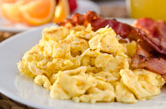 Scrambled eggs with crispy bacon Royalty Free Stock Image