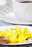 Scrambled eggs, cup of coffee and toast. Royalty Free Stock Photography