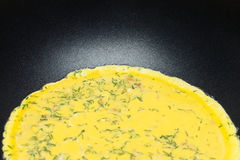 Scrambled eggs with dill cooking Stock Images
