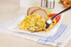 Scrambled eggs on fork. Stock Images