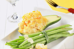 Scrambled eggs with avocado and green beans Stock Images