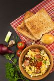 Scrambled eggs with fried bacon. English breakfast. Toast and scrambled eggs with chives. Royalty Free Stock Images