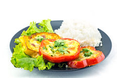 Scrambled eggs fried in the ring of sweet pepper. Stock Images
