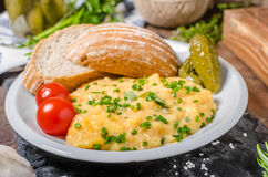 Scrambled eggs in a frying pan Stock Image