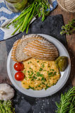 Scrambled eggs in a frying pan Royalty Free Stock Photo