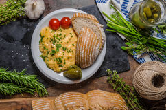 Scrambled eggs in a frying pan Royalty Free Stock Image