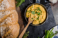 Scrambled eggs in a frying pan Stock Photo