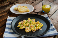 Scrambled eggs on frying pan Royalty Free Stock Image