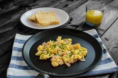 Scrambled eggs on frying pan Royalty Free Stock Photos