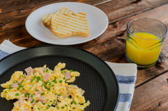 Scrambled eggs on frying pan Royalty Free Stock Images