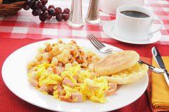 Scrambled eggs with ham. Scrambled eggs with diced ham and potatoes O'Brian Royalty Free Stock Photography
