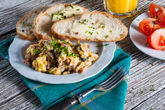 Scrambled eggs with ham. Scrambled eggs with ham and chives Stock Photography