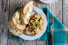 Scrambled eggs with ham. Scrambled eggs with ham and chives Royalty Free Stock Image