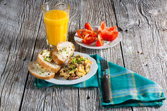 Scrambled eggs with ham. Scrambled eggs with ham and chives Stock Image