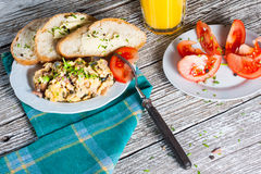 Scrambled eggs. Scrambled eggs with ham and chives Royalty Free Stock Image