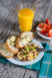 Scrambled eggs with ham. Scrambled eggs with ham and chives Stock Photo