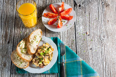 Scrambled eggs. Scrambled eggs with ham and chives Stock Photo