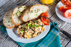 Scrambled eggs. Scrambled eggs with ham and chives Stock Photos