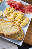 Scrambled eggs with ham stock photography