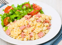Scrambled eggs with ham and salad Royalty Free Stock Image