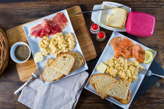 Scrambled eggs with ham and salmon royalty free stock photos