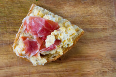 Scrambled eggs with ham stock images
